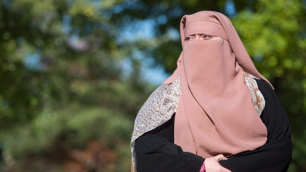 Quebec's Face-Covering Law Heads for Constitutional Challenge