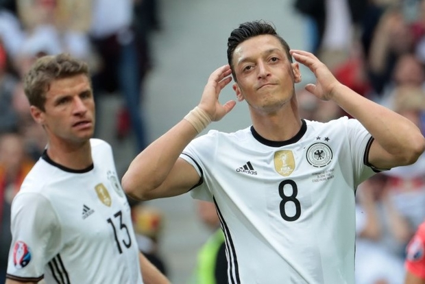 Why the Pressure of Being 'A Good Immigrant' Got to Mesut Ozil