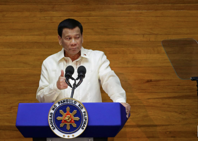 Philippine Leader Approves Autonomy Law for Troubled Muslim Region