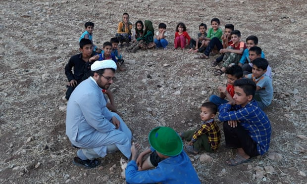 No Turban, No Sermon, Just Books for Kids: Meet Iran's Traveling Cleric
