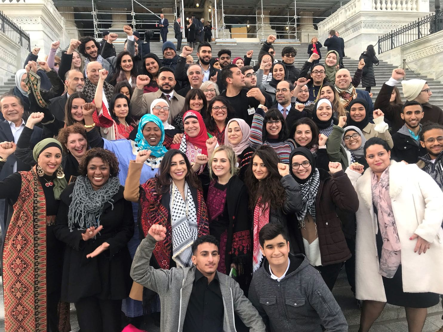 The nation's first two Muslim congresswomen are sworn in, surrounded by the women they inspired