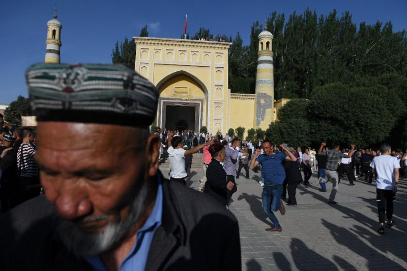 Wrecked mosques, police watch: A tense Ramadan in Xinjiang