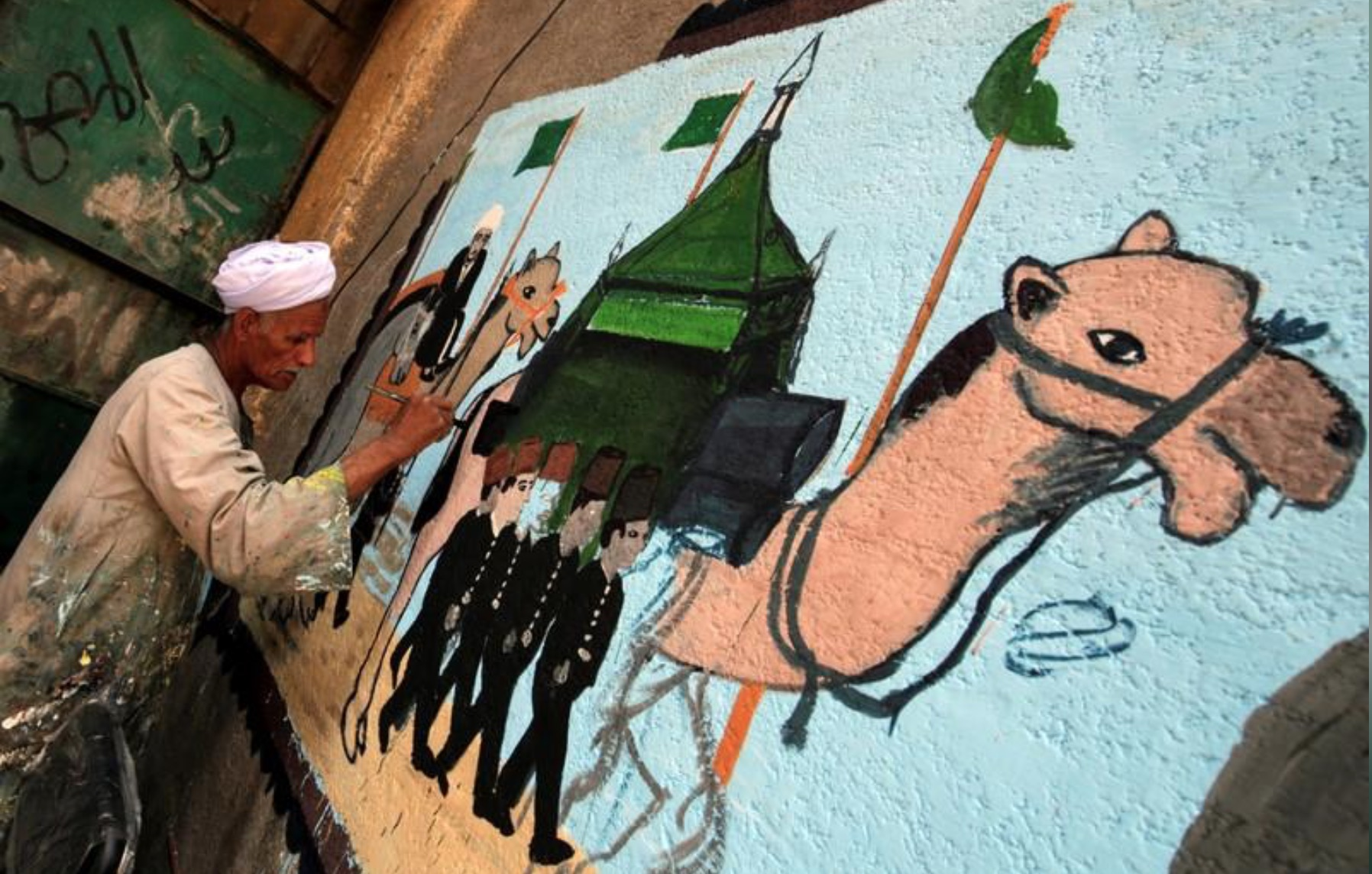 Egyptian artist paints murals on houses to celebrate haj