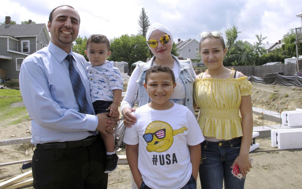 In a divided US community, Syrian refugee family settles in